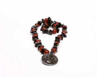 Rebel Behavior carnelian,  onyx and Hematite lion pendant necklace