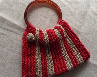 Round handled crocheted red and gold small handbag