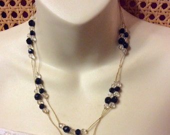 Vintage 1980's black clear faceted glass beads beaded necklace .