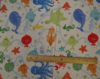 White With Multicolored Turtle/Fish/Sea Animal Flannel Fabric  by the Yard