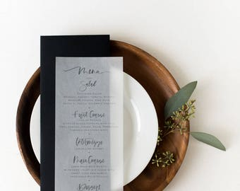 Hand lettered brush calligraphy wedding and event menu on Vellum