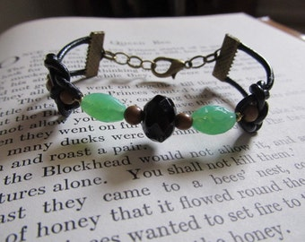 Item 2222 Black and Sea Green Double Coin Knot Bracelet