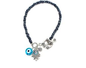 Hippie gypsy hamsa evil eye metallic black seed bead bracelet