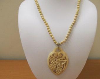 Carved Horn Grape Leaf Necklace Item W-#495