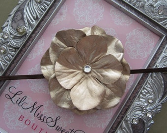 Crayola Gold colored flower on a brown skinny elastic headband, perfect for fall for all ages, for newborn photo shoots to adults