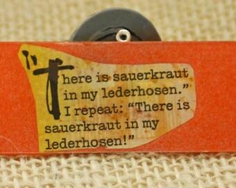 Hilarious Sauerkraut in Lederhosen Quote Glass Slide Pendant Women Sparkly orange and golden yellow Upcycled Beer bottle label pendant