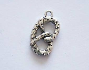 5 Pretzel Charms. Tibetan Silver.