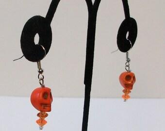 orange dangle skull earrings cute but creepy