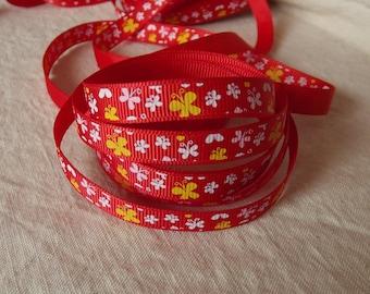 R25 - Ribbon grosgrain red butterflies - 10 mm - 1 M