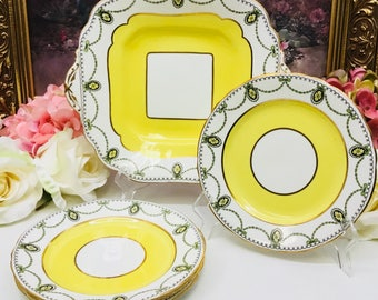 Aynsley cake plate and four dessert plates circa 1905-1925.