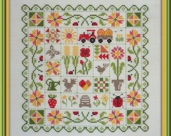 Patchwork Summer – counted cross stitch chart to work in 7 colours of DMC thread.  Traditional style patchwork and flower motifs are used