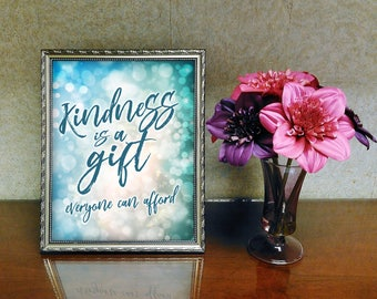 Kindness is a gift everyone can afford. Kindness quote in blue magical background.