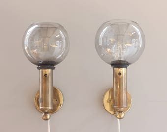An elegant pair of wall scones in brass glass by Bergboms