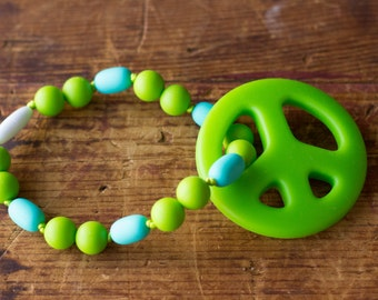Chompy Silicone Peace Sign Babywearing Accessory