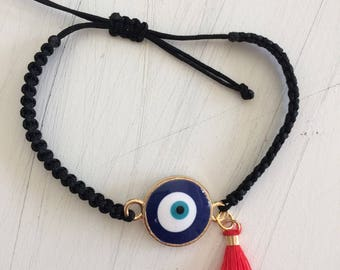 eye bracelet with tiny tassel