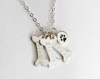 Dog bone necklace etsy dog bone necklace personalized dog name pet loss gift pet memorial loss of pet silver or gold paw print dog memorial paw print necklace aloadofball Images
