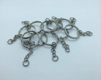 Set of 10 silver keychain hardware - destashing my lot of supplies.  These include all you need to make your custom piece into a keychain.
