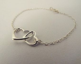 Sterling Silver linked hearts bracelet. Two hearts bracelet. Interlocking Floating Hearts Love Links. Dainty hearts jewelry. Valentines gift