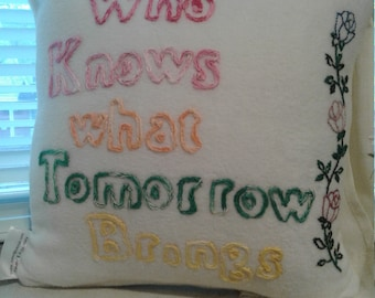 Who knows what tomorrow brings pillow