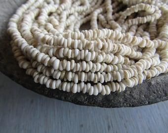 Mini tiny beige rondelle lampwork glass beads, delicate, opaque cream semi matte, Indonesian  1 to 1.5 x 3mm ( 22 inches strand ) 7bb13-4