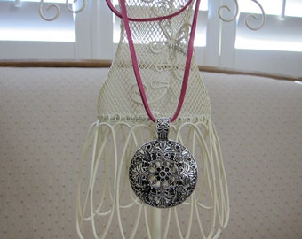 Silver Tibetan Filigree Medallian Pendant and Pink Swede Cord