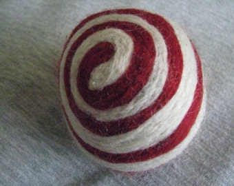 One multi-colored felted pin-cushion, Red and White