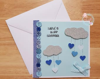 Baby Shower card. glittered clouds. heart raindrops. button embellishments. Button art. Raining Love. Bow detail. Baby girl. Baby boy