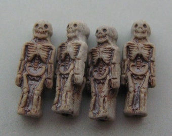 4 Tiny High Fired Skeleton Beads