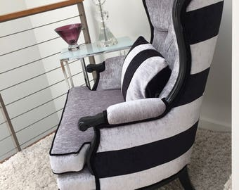 Vintage wing chair with bold stripes