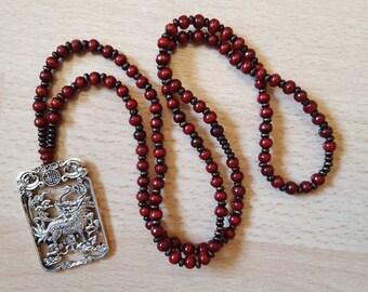 JAPAMALA of 108 sandalwood beads with Tibetan silver Pendant