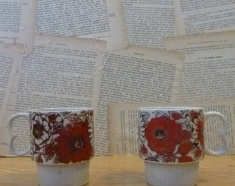 Pair of Stackable Red and Black Flower Mugs - Daisies