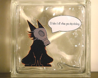 i'll take it off when you stop stinking (glass block)--a print of a drawing of a cartoon-sytle cat in a gas mask on a glass block