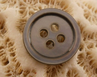 BUTTONS:  Shell, mother of pearl gray buttons.  Very well made and very uniform for shell buttons.  5/8 inch. Set of 12 buttons.