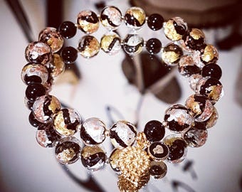 Bracelet in Murano glass with 9 k gold beads and sterling silver pl.or