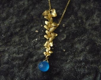 Necklace orchid with blue gemstone