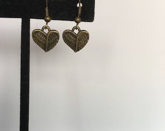 Brass heart and wing earrings