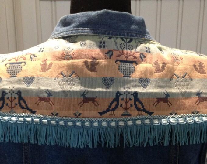 Womens upcycled denim vest vintage pink aqua tapestry aqua fringe trim on back tapestry on front pockets fringed tapestry back western look