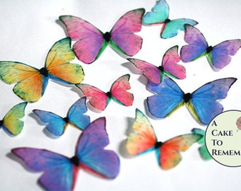 Rainbow edible butterflies, 12 wafer paper butterflies for wedding cake toppers. Butterflies for cake decorating and cupcake decorating.