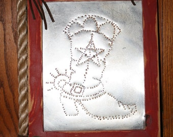 Western boot tin punch with red frame accented with twine rope leather fringe and concho