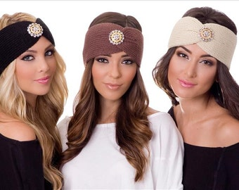 Turban style knitted ear warmer headband with a gold plated rhinestone brooch