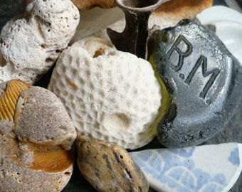 A COLLECTION of beach treasures, sea glass, coral, shells, natural history stones metal bottle neck pottery blue green