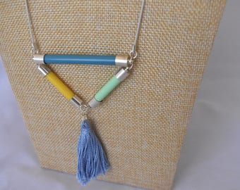 Geometric Tassle necklace made from recycled vintage knitting needles and blue embroidery thread tassle