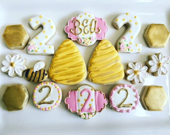 1 dozen bee birthday decorated cookies. Perfect for any birthday age- evetything custom! Gold, pink and yellow. Gender reveal