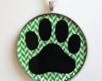 Paw Print  Ornament - Choose your background pattern -paw print silhouette with colorful holiday background