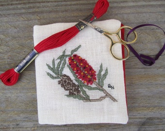 Cross stitch needlebook on cream coloured evenweave and red fabric lining - Australian Bottlebrush