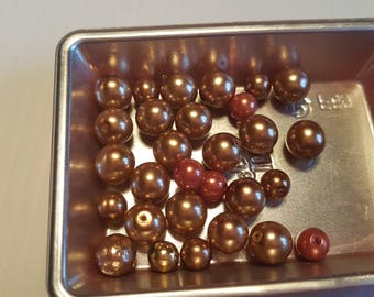 Melange and round beads gold red