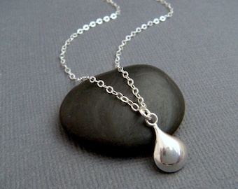 silver teardrop necklace. small puffed oval drop. puff teardrop jewelry. simple sterling pendant. dainty delicate. modern gift for her