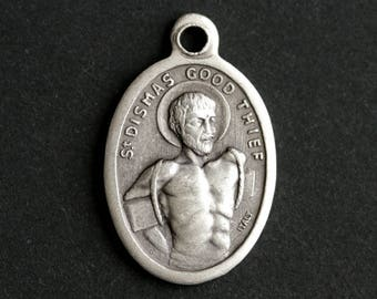 Saint Dismas Medal. Catholic Pendant. St Dismas Pendant. Saint Dismas Charm. Good Thief Catholic Saint Medal. 25mm x 16mm (Qty 1)