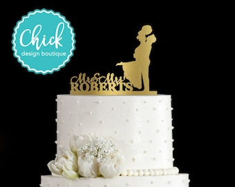 Custom Name and Groom Holding Bride Wedding Cake Topper Hand Painted in Metallic Paint
