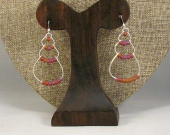 Silver wire bubble earrings with purple beads